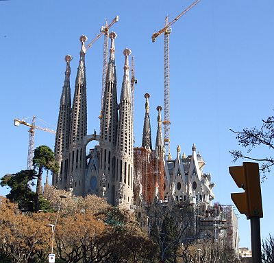 Distant view of the Fa¸ana de la Passió side of the Temple Expiatori de la Sagrada Família of Antoni Gaudí, ths side by Josep Subirachs