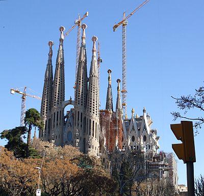 Distant view of the Fa¸ana de la Passió side of the Temple Expiatori de la Sagrada Família of Antoni Gaudí, ths side by Josep Subirachs