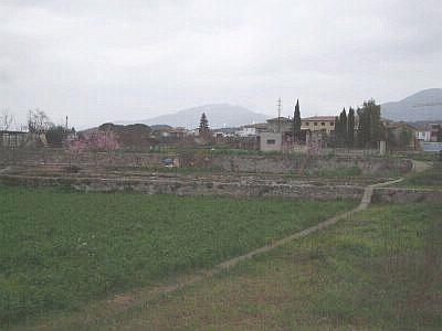 The Horts de Besalú taken from the river through a mist of rainfall