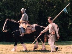 Reenactors play a thegn and attendant setting off to war