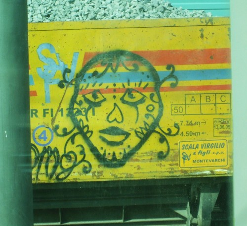 Graffito on a gravel truck at the trackside just outside Florence