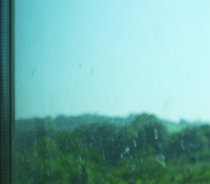 Perhaps the hill of Poggibonsi, through a glass muzzily