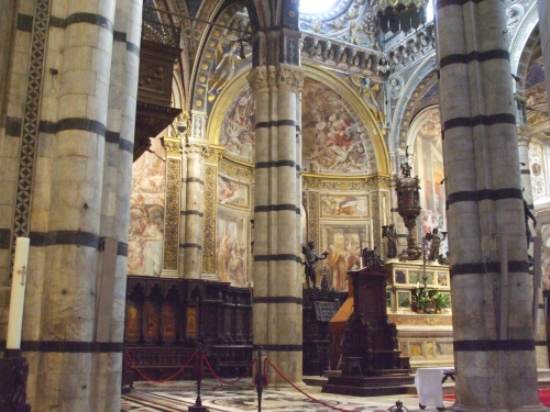 Interior of Siena cathedral around the apse and choir, from south transept