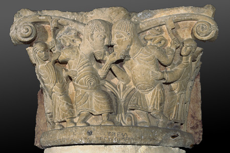 Eleventh-century capital from Poitiers showing two men squaring up to fight, with a woman behind each trying to pull them apart