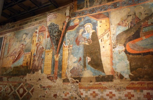 Romanesque fresco painting in the crypt of Siena cathedral, showing the Annunication and Visitation