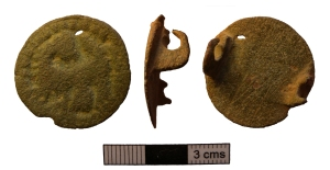 Ninth-century Saxon disc brooch with backwards beast decoration