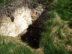 Remains of a cistern (not actually a cell, sorry) dug into the hilltop of the Castell de Gurb