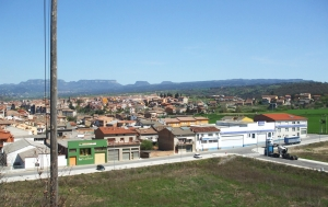 Outskirts of Roda de Ter, and trucks, viewed from la Muntanyeta