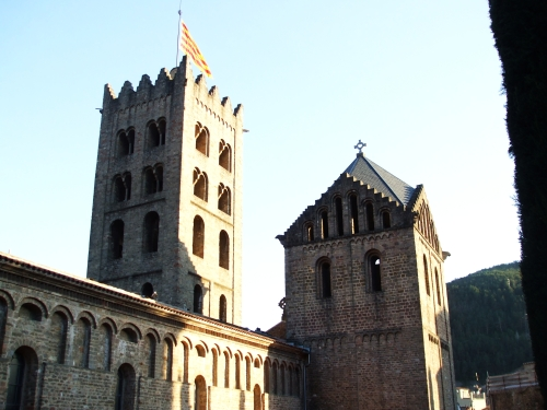The two western towers of Santa Maria de Ripoll in slanting evening sunlight