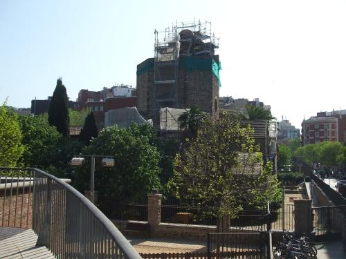 Sant Pau del Camp, Barcelona, in scaffolding shroud, from the nearby walkway