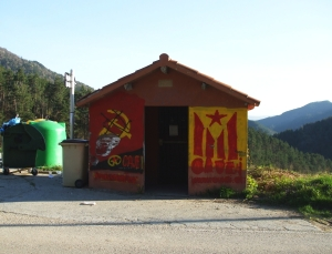 A heavily-graffitied bus shelter in Vallfogona
