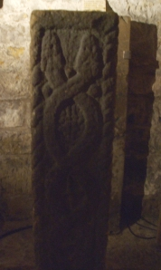Carved stone in the crypt of St Mart's Lastingham, showing two serpents intertwined