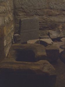 Cross-bases and other stone fragments from inside the blind stairwell in the crypt of St Mary's Lastingham