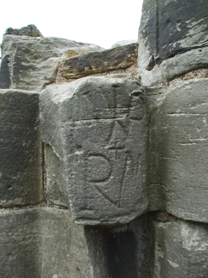 Inscribed stone reused in one of the arcade columns at Whitby Abbey