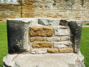 Exposed core of a ruined column at Whitby Abbey