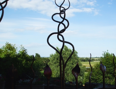 Skyline over the Sussex countryside seen through sculptures at the top of Rye