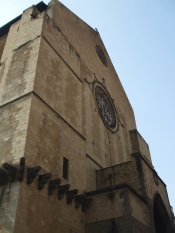 Portal and upper west face of Santa Chiara, Naples