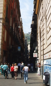 A view of the hills around Naples down the apex of a city street