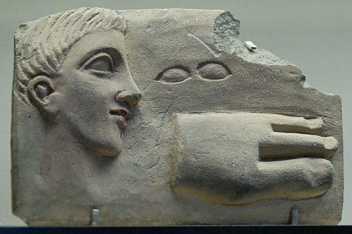 A Roman votive plaque on show at the Musée du Louvre