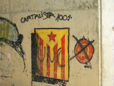 Graffiti reading `100% capitalista` with Catalan flag from Gurb, Osona