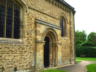 South portal of church of St Mary the Virgin Iffley, showing nearby windows and ornament