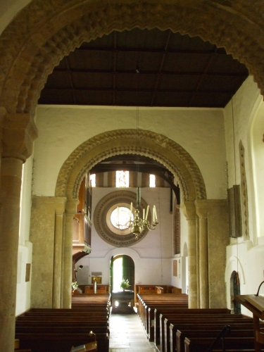 Interior of church of St Mary the Virgin, Iffley, seen from the entry to the chancel looking east
