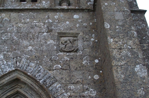 Detail on St Michael's tower, Glastonbury, showing St Brigit milking