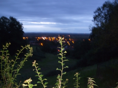 View of Glastonbury by night from above the town