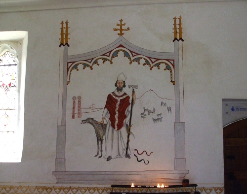 Mural painting of St Patrick by Fleur Kelly in St Patrick's chapel, Glastonbury Abbey