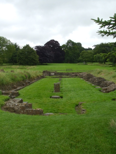Ruins of the refectory, Glastonbury Abbey, looking towards the Tor