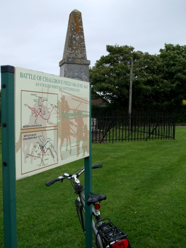 Noticeboard detailing the Battle of Chalgrove Field, with the memorial behind