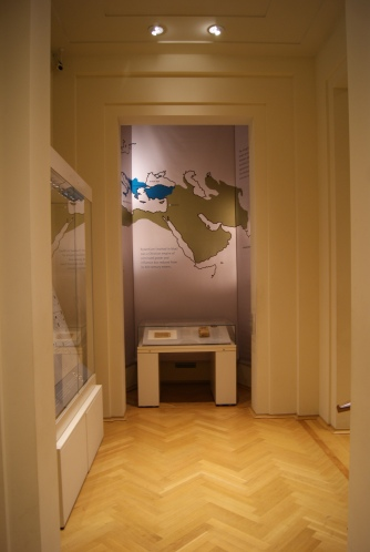 Two of the cases of the Faith and Fortune exhibition currently on inthe coingallery of the Barber Institute of Fine Arts