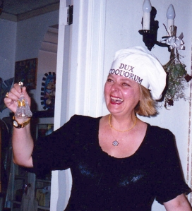 "Picture of interior designer and cookery book writer Valentina Cirasola wearing a hat marked ""dux coquorum"", roughly ""head cook"", borrowed from her website"