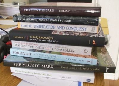 A stack of books bought at Leeds IMC 2013