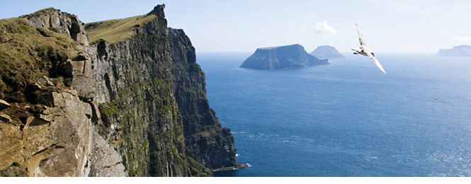 View from the south-eastern extremity of Sandoy in the Faroe Islands, looking south down the chain