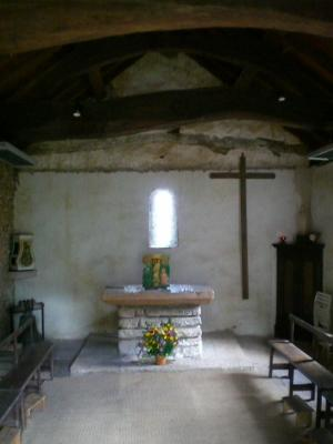 Interior view of Saint-Laurent de Collonge, Lournand, showing altar