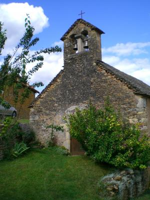 Exterior view of Saint-Laurent de Collonge, Lournand, showing portal and bell-tower