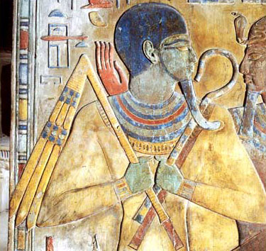 A depiction of of the god Osiris from the tomb of Seti I, with crook and flail