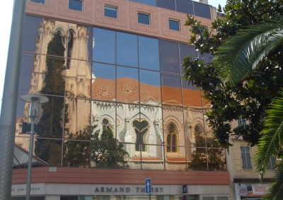 The church of Notre Dame de Nice, reflected on a neighbouring building