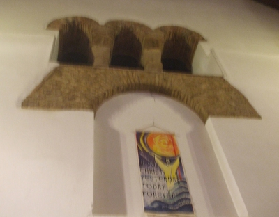 The characteristic triple arch feature at the west of the nave in All Saints Brixworth
