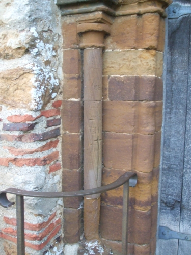 Markings around the portal of All Saints Brixworth