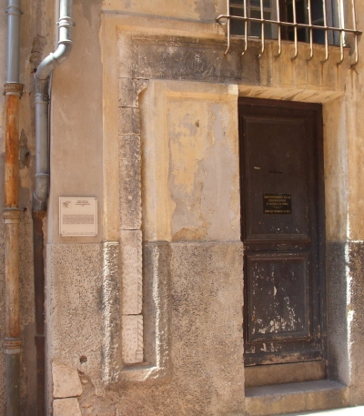 """What the signage calls a """"Middle Age Lintel"""", the oldest standing architecture in Nice (1485, apparently)"""