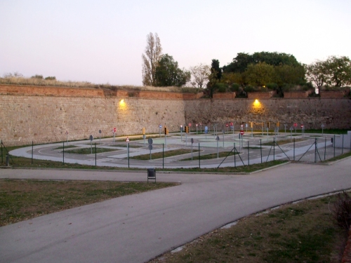 Cycling practice park outside walls of Castell de Montjuïc, Barcelona