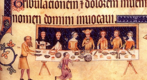 A dining scene from the Luttrell Psalter