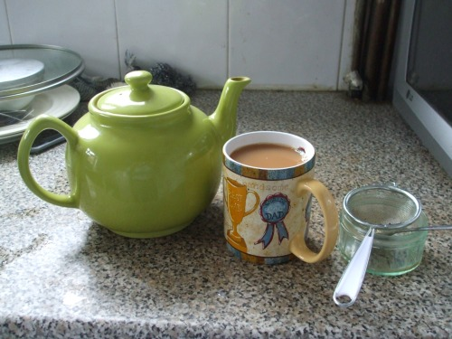 Teapot, mug and strainer in my kitchen