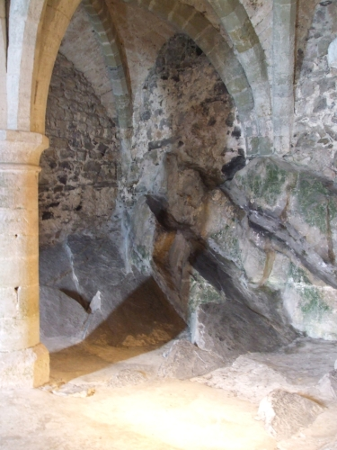 The natural rockface in the prison chamber of the Château de Chillon