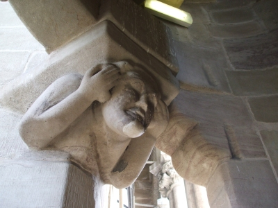 Humanoid grotesque from inside the tower of Geneva Cathedral