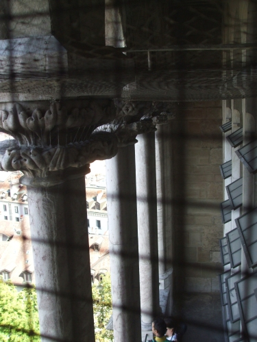 Capitals and columns in the west front off Geneva Cathedral, seen from inside one of its towers