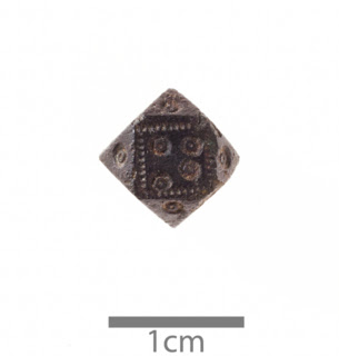 A Viking cuboctohedral weight with four dots on it
