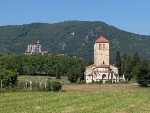 The cathedral of Saint-Bertrand de Comminges in the distance, with the Romanesque church of Saint-Just de Valcabrère in the foreground
